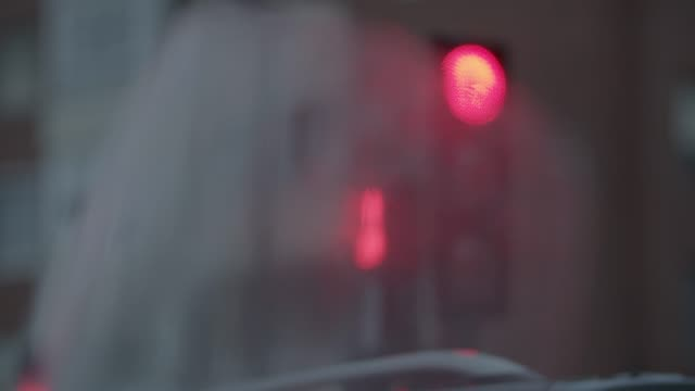 Looking at traffic lights through wet motorcycle windscreen