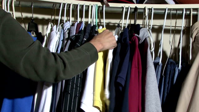 Looking in Closet Looking for a shirt to wear. sweatshirt stock videos & royalty-free footage