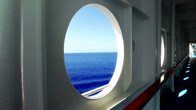 looking out at sea from cruise ship porthole - cruise video stock e b–roll