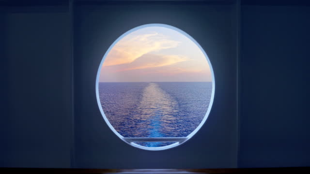 looking out at wake from cruise ship porthole - cruise video stock e b–roll