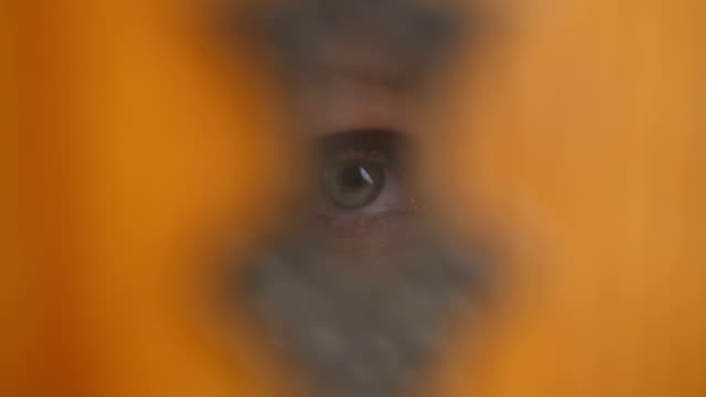 Looking Threw the Keyhole The camera pushes in to reveal a person looking threw the keyhole. This file is loop-able, and has a shallow depth of field. keyhole stock videos & royalty-free footage