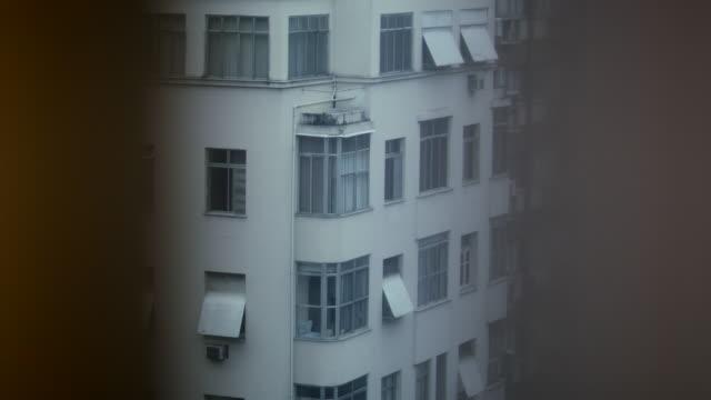 Looking through apartment window perspective, building facade