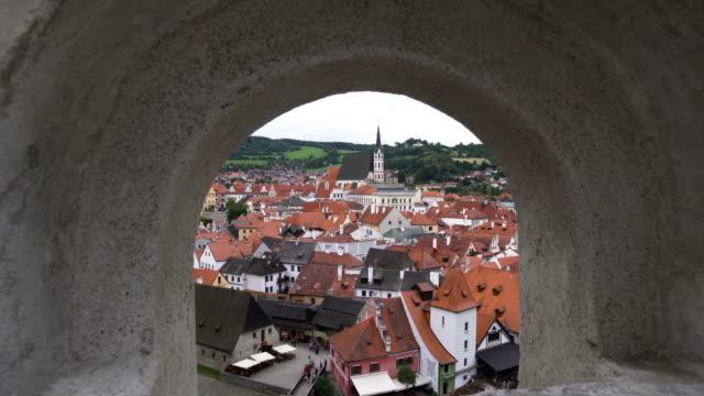 looking through arch window to see Cesky Krumlov city