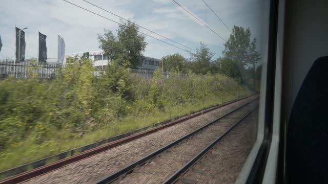 looking through the window of a train - pojazd lądowy filmów i materiałów b-roll