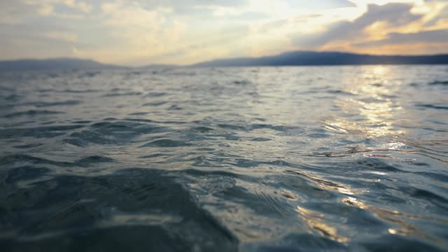 Looking towards the horizon while swimming in sea