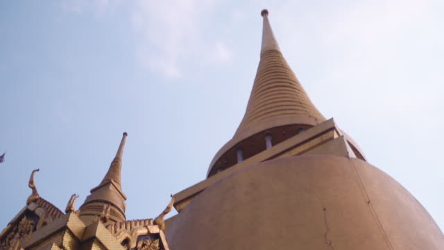 looking up at thai gold padoga architecture.Wat Phra Kaew,Temple of the Emerald Buddha in Bangkok, Thailand. panning shot