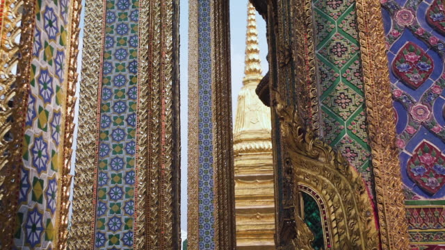 looking up at thai temple architecture.Wat Phra Kaew,Temple of the Emerald Buddha in Bangkok, Thailand. panning shot