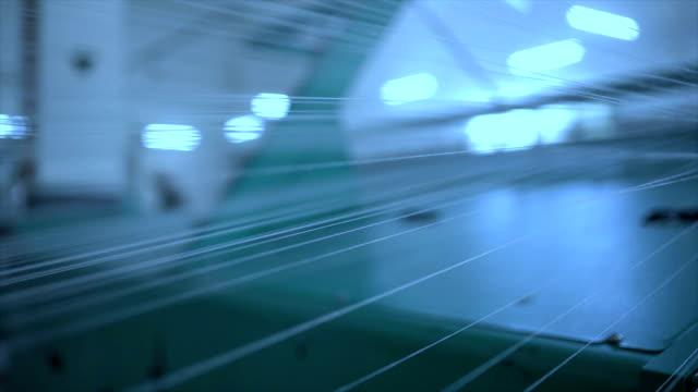 loom under working in the denim workshop - dżinsy filmów i materiałów b-roll