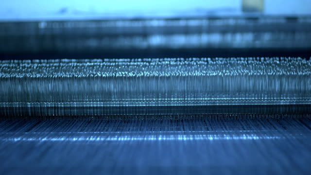 loom under working in the denim workshop - cilindro video stock e b–roll
