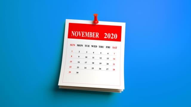 loop 3d november month page of calendar 2020 year on blue background - ноябрь стоковые видео и кадры b-roll