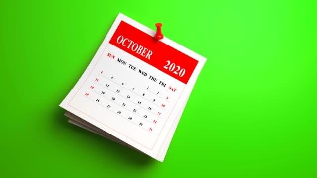 loop 3d october calendar 2020 year on green background - ноябрь стоковые видео и кадры b-roll