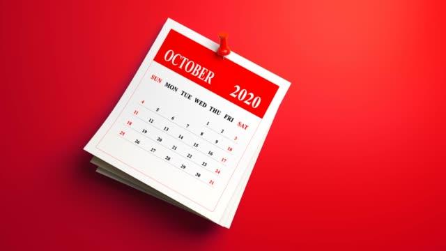 loop 3d october calendar 2020 year on red background - ноябрь стоковые видео и кадры b-roll