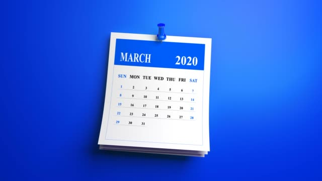 loop march page of calendar 2020 year on blue background - marzo video stock e b–roll