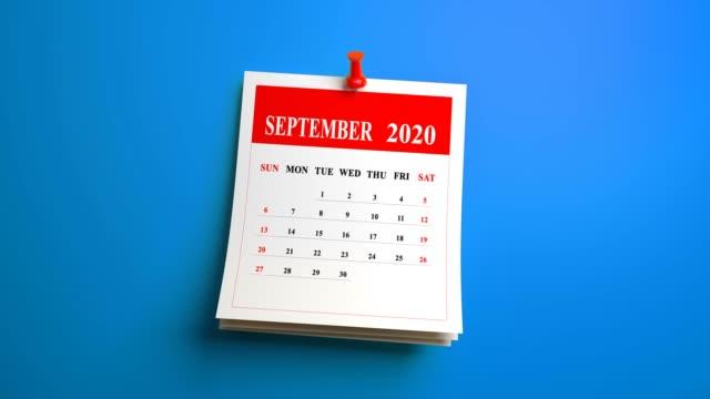 vídeos de stock e filmes b-roll de loop september page of calendar 2020 year on blue background - setembro
