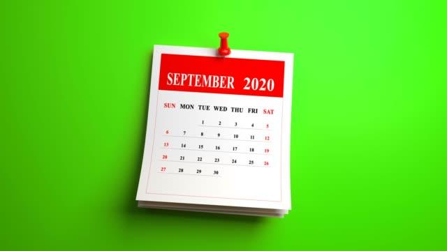 vídeos de stock e filmes b-roll de loop september page of calendar 2020 year on green background - setembro