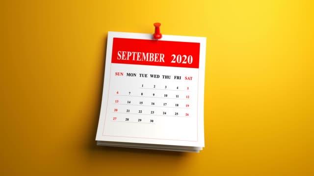 vídeos de stock e filmes b-roll de loop september page of calendar 2020 year on yellow background - setembro