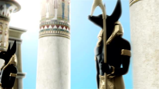 loop statyer av anubis nära egyptiska kolumner - egyptisk kultur bildbanksvideor och videomaterial från bakom kulisserna