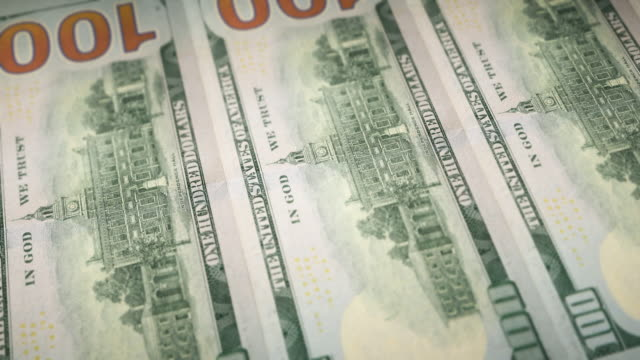 Loopable Close-up of Printing $100 Dollar Bills, Bureau of Engraving and Printing Closeup side view of sheetfed printing reverse side of $100 bills, U.S. Currency us paper currency stock videos & royalty-free footage