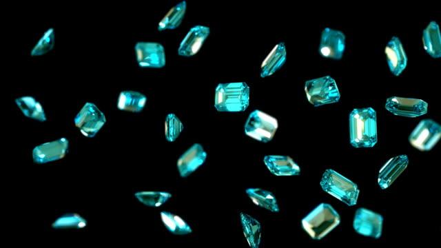 vídeos de stock, filmes e b-roll de emerald fluxo de diamantes circulares com câmera lenta - esmeralda