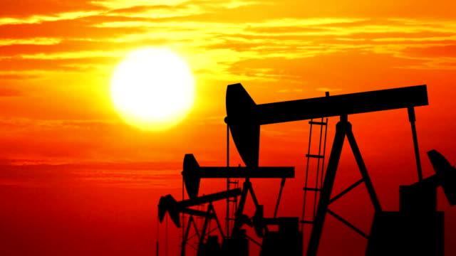 Loopable oil pumps (jackpumps) at sunset - HD1080 progressive.