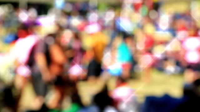 Loopable! Slow motion colorful anonymous festival crowd. Abstract background. video