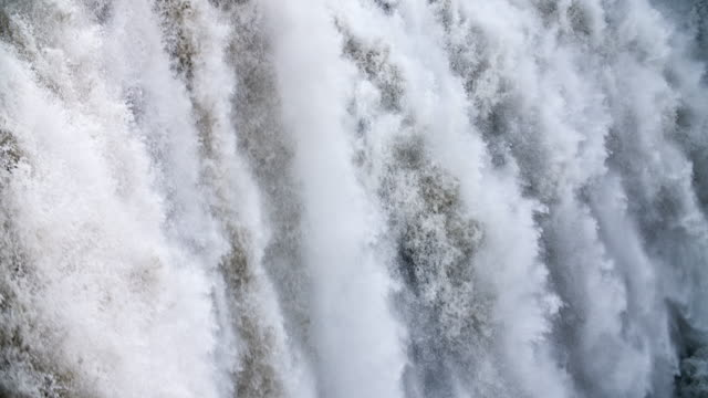 Loopable Slow Motion: Waterfall Close Up Loopable Super slow motion of water masses falling down a Waterfall in Iceland. rapids river stock videos & royalty-free footage