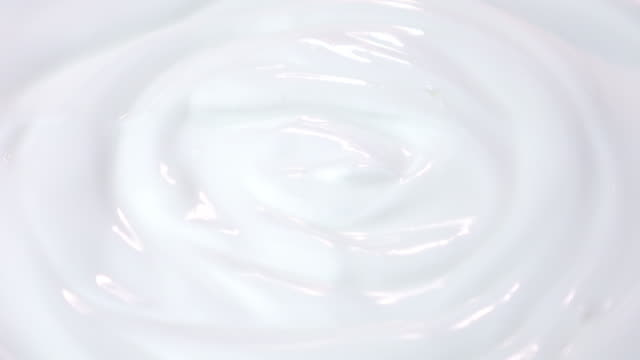 Loopable video of swirling yogurt in 4K video
