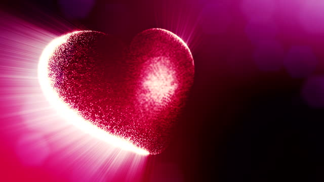 Looped 3d animation of glow particles form 3d red heart with depth of field and bokeh. For valentines day or wedding background as seamless background with space for text and light rays. V1 video