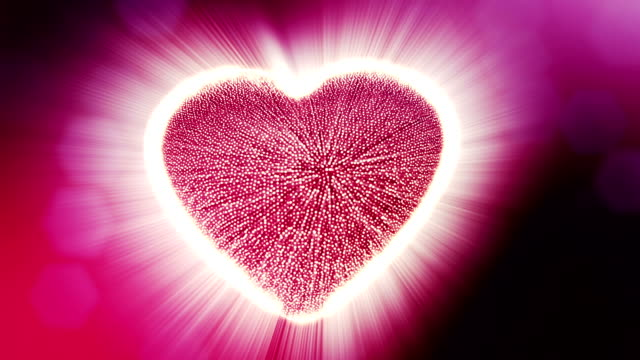 Looped 3d animation of glow particles form 3d red heart with depth of field and bokeh. For valentines day or wedding background as seamless background with space for text and light rays. V10 video