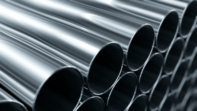 Looped animation of Metallic Pipes. Camera moving near rows of tubes. Construction Concept. video