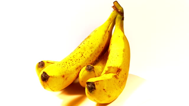 Looped: bunch of ripe tasty yellow bananas spinned video