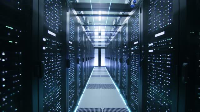 Looped Cinemagraph: Activating Data Center with Server Racks Full of Blinking LED Lights.