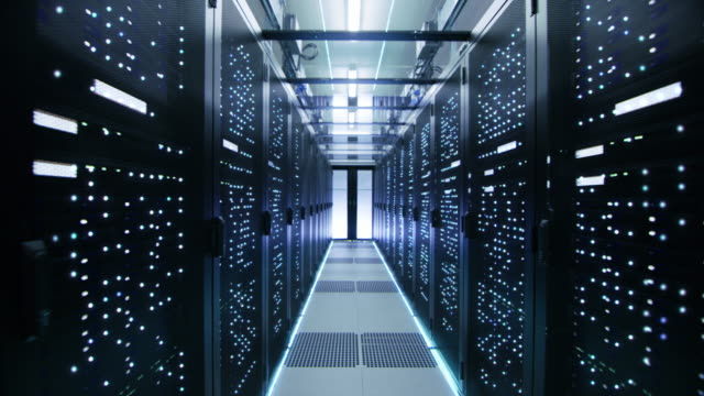 Looped Cinemagraph: Moving Through Endless Data Center with Server Racks Full of Blinking LED Lights.