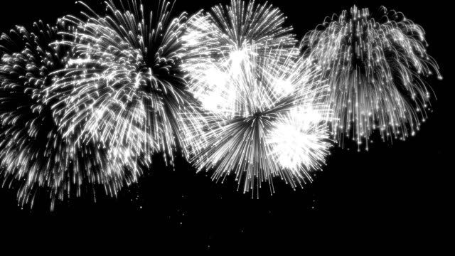 Looping Matte Isolated Fireworks A looping background matte of multiple fireworks over black background. firework explosive material stock videos & royalty-free footage
