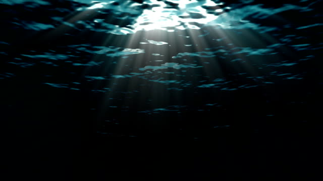 Looping ocean waves, underwater. Light rays. video