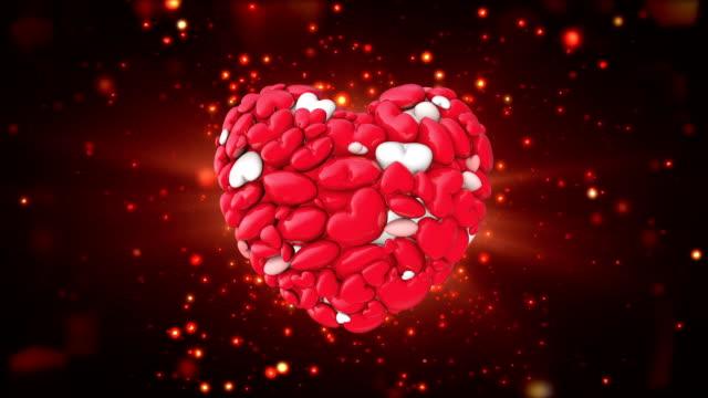 光沢のある宝石甘いキャンディの心をループを打つ - バレンタイン チョコ点の映像素材/bロール
