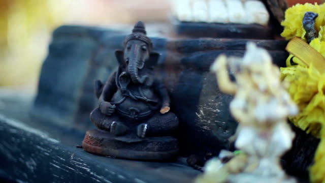 Lord Ganesha and Hinduism. Deity Ganesha with flowers, Ganesha as a symbol of Hinduism, the God of wisdom and prosperity. 1920x1080, hd video