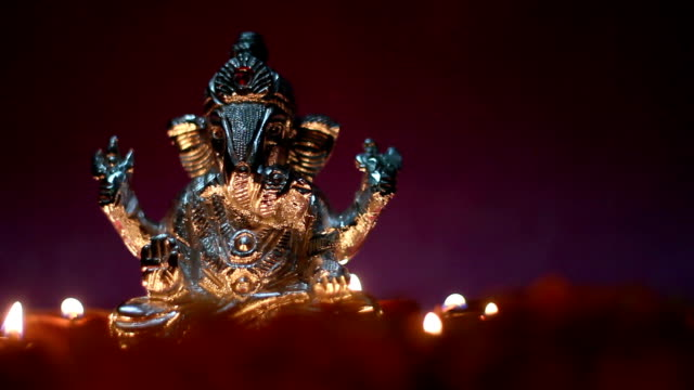 lord ganesha with clay oil lamp and flowers, space for text video