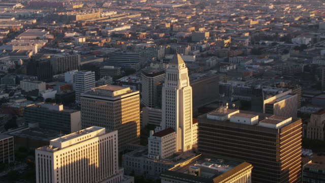 aerial los angeles city hall building at sunset - american architecture stock videos & royalty-free footage