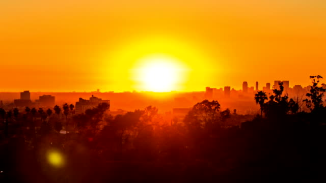los angeles city views at sunset and moving lens flare - time lapse - sunset stock videos & royalty-free footage