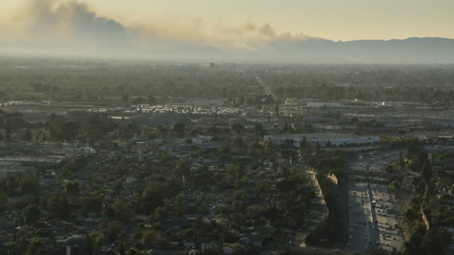 Los Angeles freeway traffic and spreading wildfire - 4k time lapse video
