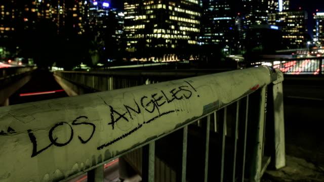 Los Angeles graffiti in busy cityscape - 4k resolution video
