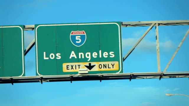 los angeles hollywood 5 fwy sign in slow motion - road signs stock videos and b-roll footage