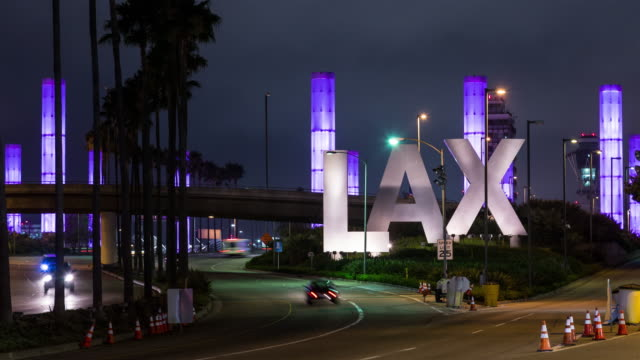 Los Angeles International Airport LAX Sign and Traffic Night Timelapse video