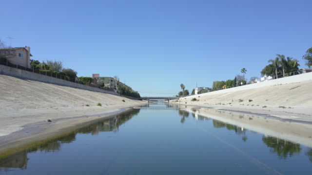 Los Angeles River Flyover Low drone flight over water in the Los Angeles River on a sunny day. aqueduct stock videos & royalty-free footage