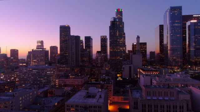 Los Angeles skyline at Dusk revealed An aerial reveal of the Los Angeles skyline at dusk. earthquake stock videos & royalty-free footage