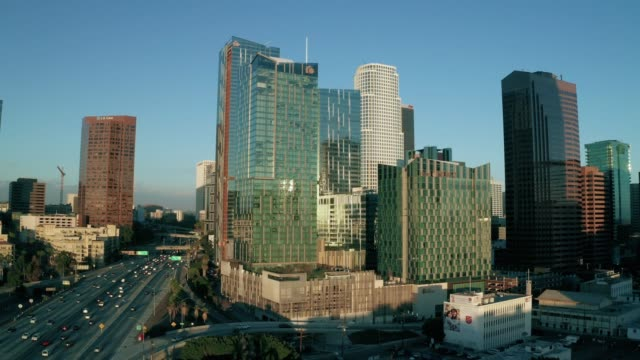 Los Angeles Skyscrapers- 4K Drone Footage Aerial drone shot of the skyscrapers, surrounding business and the 110 freeway in downtown Los Angeles. b roll stock videos & royalty-free footage
