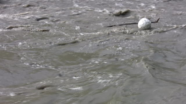 Lost soccer ball on flood river. video