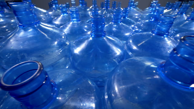 A lot of 19 liter plastic bottles for drinking water distribution. video