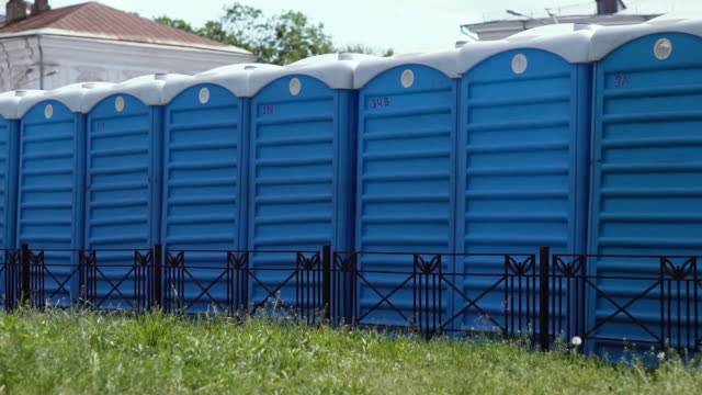 A lot of blue dry closets installed in a row on a city street for use by people during public events. Portable toilets at the venue of the festival. No people A lot of blue dry closets installed in a row on a city street for use by people during public events. Portable toilets at the venue of the festival. No people bathroom stock videos & royalty-free footage